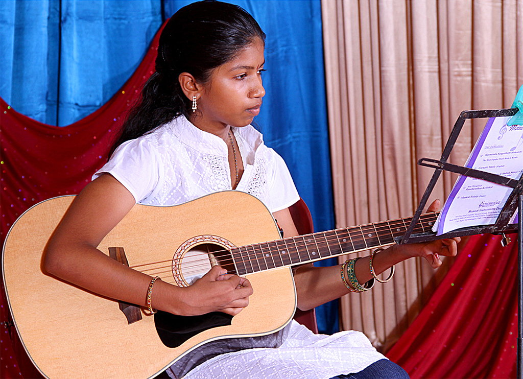 Student performs on guitar