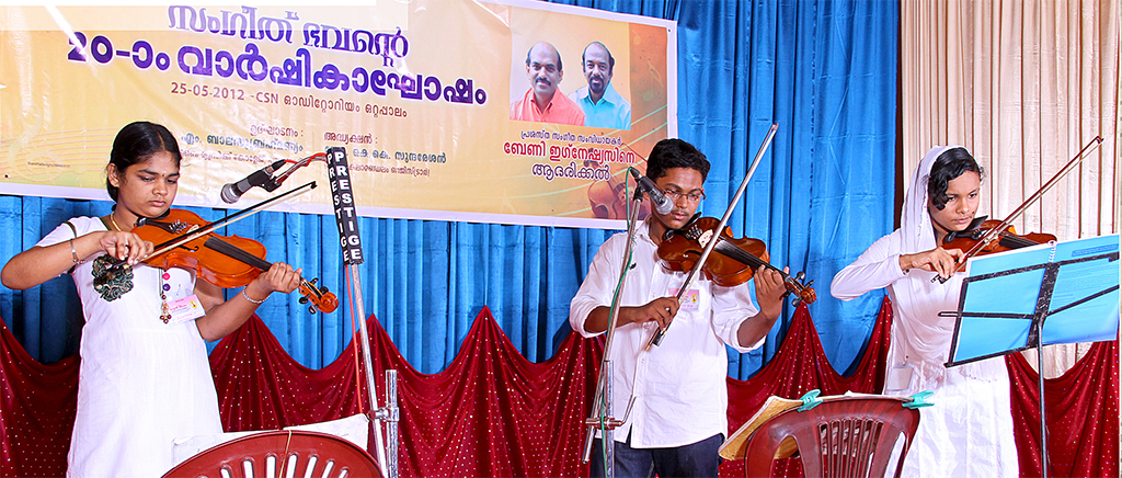 Students performing on violin
