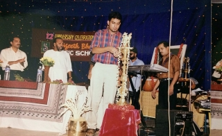 Stephen Devassy lighting the ceremonial lamp