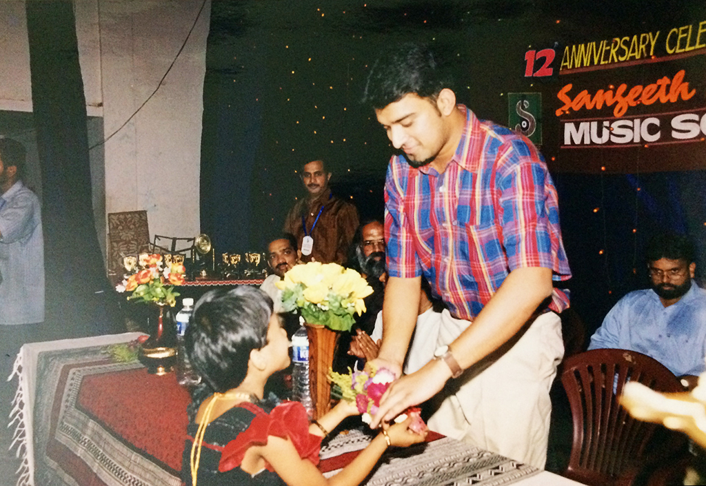 Stephen Devassy receiving boquet from child