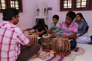 Students learning tabla